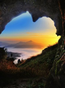 cave of hearts in misty mountainscape, Doi Pha Tang, Chiang Rai, Thailand by Anuchit